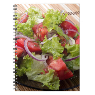 View angle on a fragment of vegetarian salad notebook