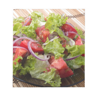 View angle on a fragment of vegetarian salad notepad