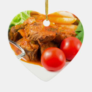 View close-up on a meal of beef stew with pasta ceramic ornament