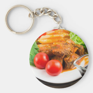 View close-up on a meal of beef stew with pasta key ring