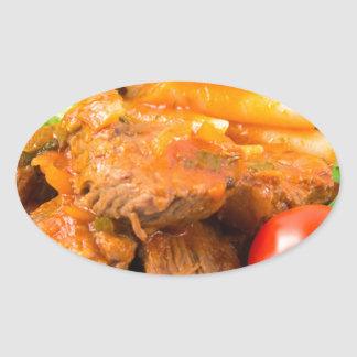 View close-up on a meal of beef stew with pasta oval sticker