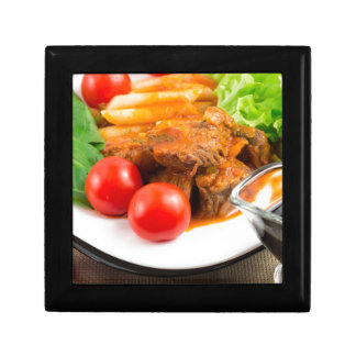 View close-up on a meal of beef stew with pasta small square gift box