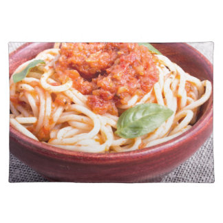 View close-up on a small portion of cooked spaghet place mats