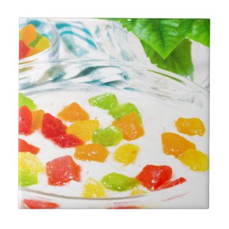 View close-up on oatmeal with colorful candied ceramic tile