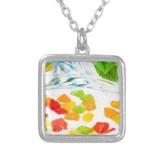 View close-up on oatmeal with colorful candied silver plated necklace