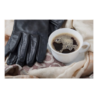 View close-up on white cup of coffee and gloves poster