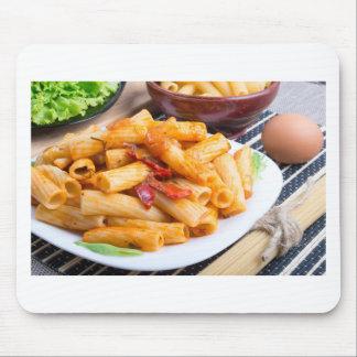 View closeup on a dish of rigatoni pasta mouse pad