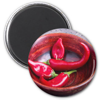 View closeup on hot red chili peppers 6 cm round magnet