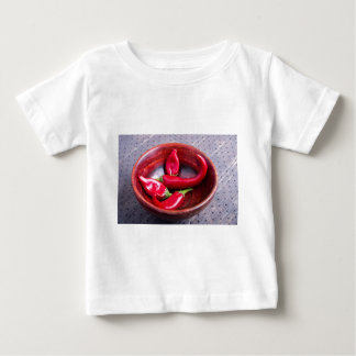 View closeup on hot red chili peppers baby T-Shirt