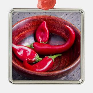 View closeup on hot red chili peppers Silver-Colored square decoration