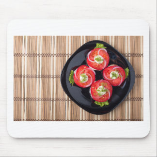 View from above on a dish with fresh sliced tomato mouse pad