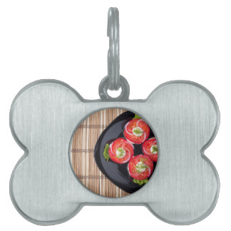 View from above on a dish with fresh sliced tomato pet ID tag
