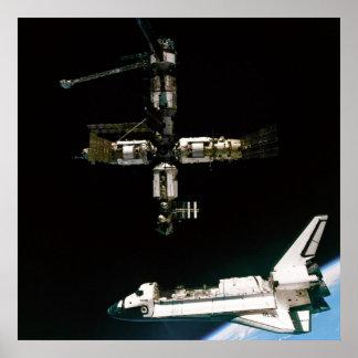 View from Soyuz of Shuttle Atlantis departing Mir Poster