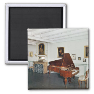 View of a room with a grand piano refrigerator magnets