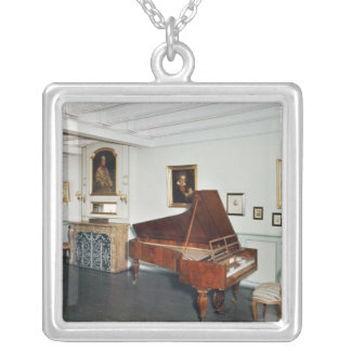 View of a room with a grand piano necklace