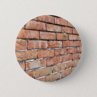 View of an old brick wall with a blur at an angle 6 cm round badge
