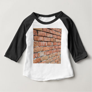 View of an old brick wall with a blur at an angle baby T-Shirt