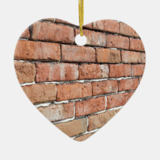 View of an old brick wall with a blur at an angle ceramic ornament