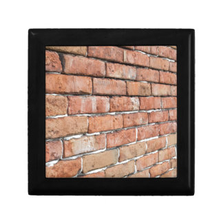 View of an old brick wall with a blur at an angle gift box