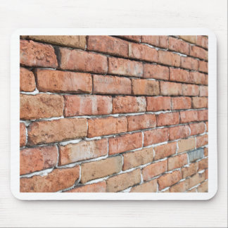 View of an old brick wall with a blur at an angle mouse pad