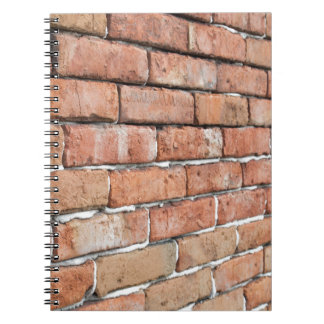 View of an old brick wall with a blur at an angle notebook