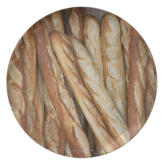 view of bread loaves in bakery window display plate