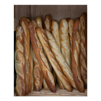 view of bread loaves in bakery window display poster