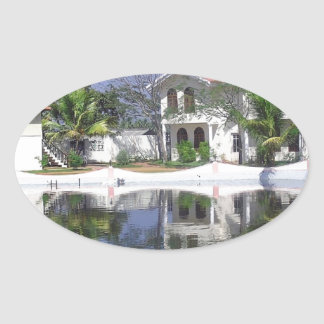 View of cottages and lagoon water in Alleppey Oval Sticker