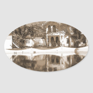 View of cottages and lagoon water in Alleppey Stickers