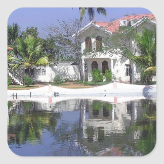 View of cottages and lagoon water in Alleppey Square Sticker