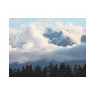 View of Grand Teton Mountains through the clouds Canvas Print