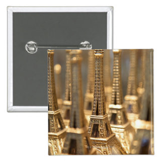 view of small eiffel towers for sale to tourists 15 cm square badge