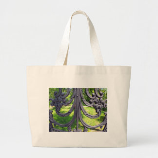 View of the city park through a lattice fence jumbo tote bag