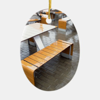 View of the outdoor cafe tables wet in the rain ceramic oval decoration