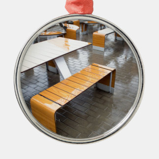 View of the outdoor cafe tables wet in the rain Silver-Colored round decoration