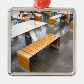 View of the outdoor cafe tables wet in the rain Silver-Colored square decoration