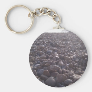 View over pebbles to silouetted West Pier Key Ring