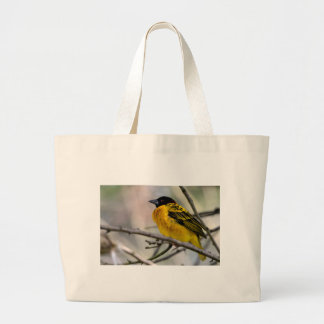 Village Weaver on branch Canvas Bags