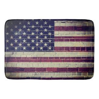 Vintage America flag on a brick wall Bath Mat