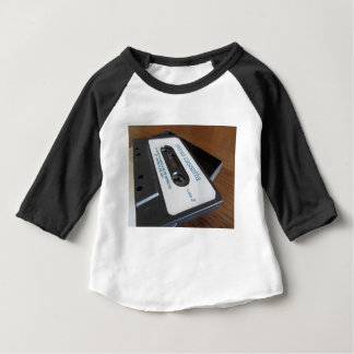 Vintage audio cassette tape on wooden table baby T-Shirt