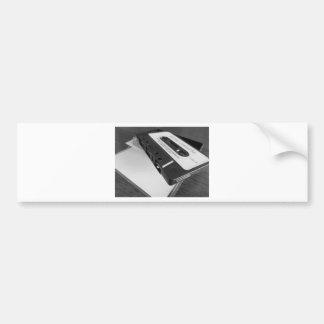 Vintage audio cassette tape on wooden table bumper sticker