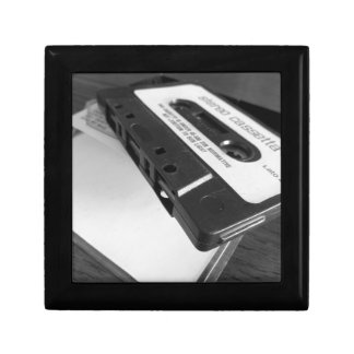 Vintage audio cassette tape on wooden table gift box