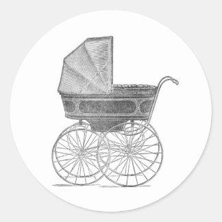 Vintage baby pram in black and white round sticker