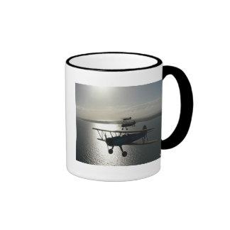 Vintage bi-planes in formation mug