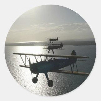 Vintage bi-planes in formation round sticker