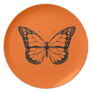 Vintage Butterfly on vibrant orange plate