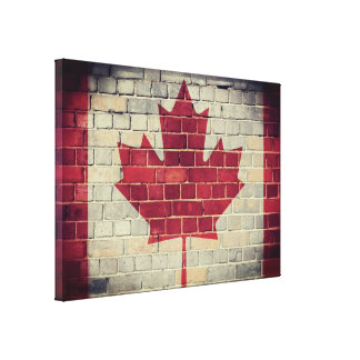 Vintage Canadian flag on a brick wall Canvas Print