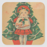 Vintage Christmas Child  infront of Tree Sticker