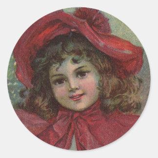 Vintage Christmas child with red Victorian Dress Round Sticker