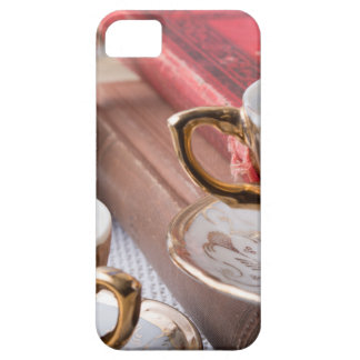 Vintage coffee cups with hot espresso and retro case for the iPhone 5